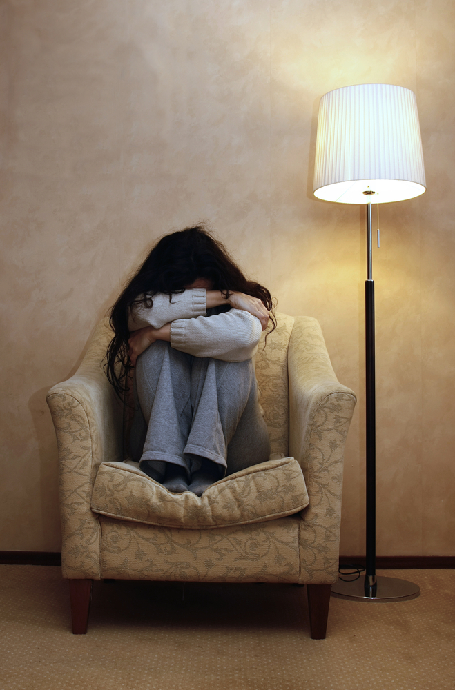 stock-photo-a-depressed-woman-with-a-closed-position-66145183.jpg