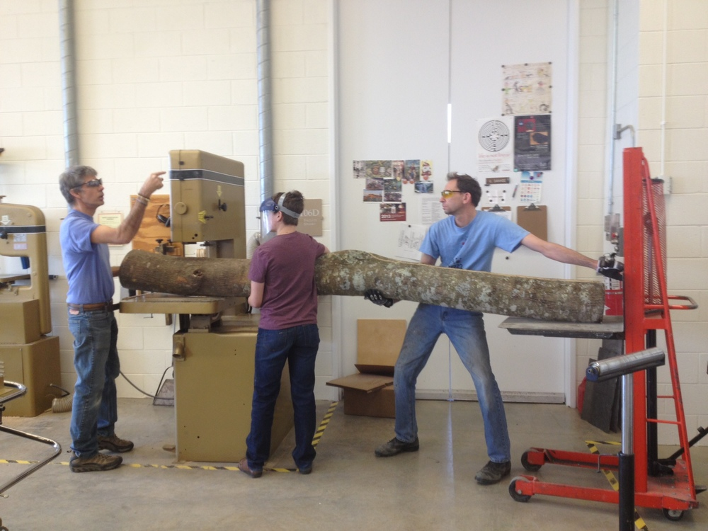 Professor Savage and Technician help student, Leah Smith ('13) with sculpture.JPG