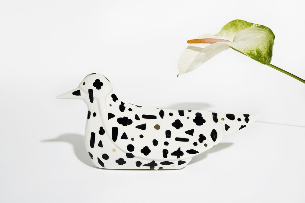 "DUCK Jaime Hayon for Bosa   A new interpretation of a celebrated icon Jaime Hayon reinterprets the Duck by Bosa, originally presented as part of 'The Mediterranean Digital Baroque' project at the David Gill Gallery in London (October 2013). Designed by Hayon for Bosa, the Brilliant Ceramics exclusive features an illusionary graphic, that reflects the eclectic aesthetic of the artist. ""We are extremely passionate about research, and are constantly looking to find the most original and tasteful objects among the many projects that we evaluate. It is always a great pleasure to work with Jaime. His sophisticated décor inspires us to push boundaries and to experiment with new materials, including ceramics."" - Francesca Bosa For Bosa, with each new projects comes an exciting challenge that tests there technical know-how. The result is a promise to enhance and understand the different forms of expression linked to the contemporary world. Jaimie Hayon's esteem and knowledge of artisan skills and his inherent creativity has allowed him to push the boundaries of many mediums and functions, resulting in collections for very diverse clients. Bosa produces unique, recognizable and high-quality objects using precise techniques. All of the objects and furnishings are created at the Maison Bosa and express an endless experimentation of the possibilities that ceramics offers, as well as an in depth knowledge of craftsmanship."