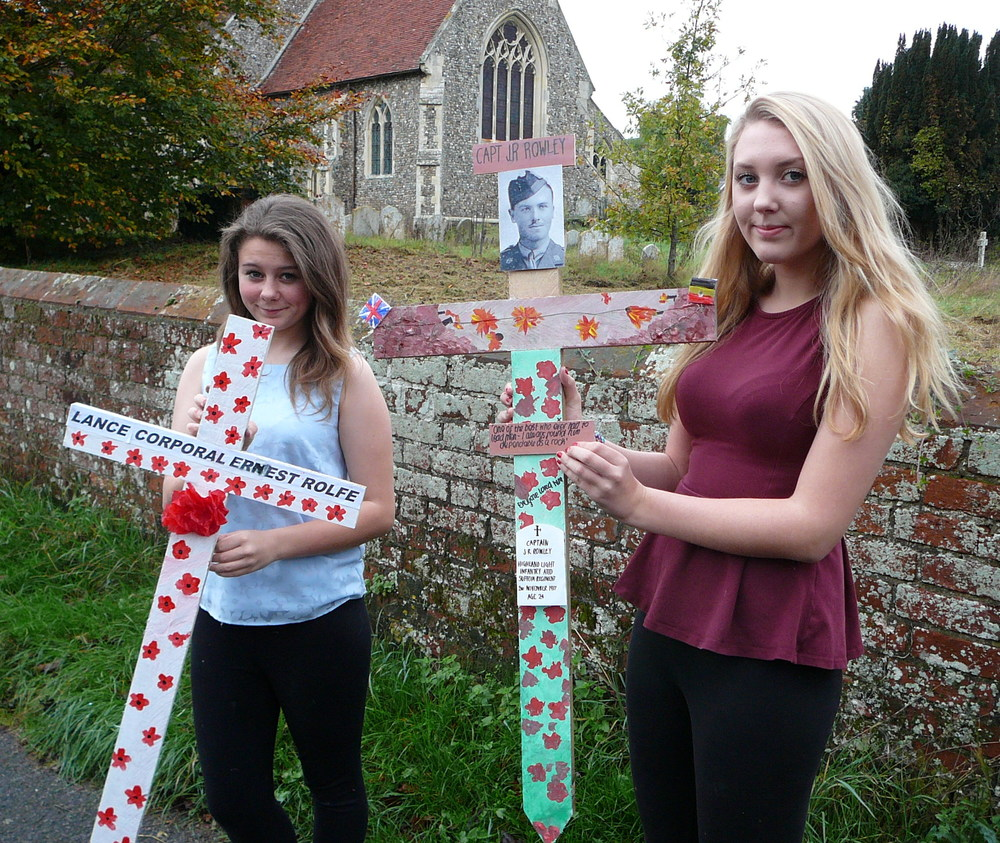 119 ELIZA BENNETT AND MEGAN BENNETT WITH THE CROSSES IN MEMORY OF ERNEST ROLFE AND JOSHUA ROWLEY.jpg