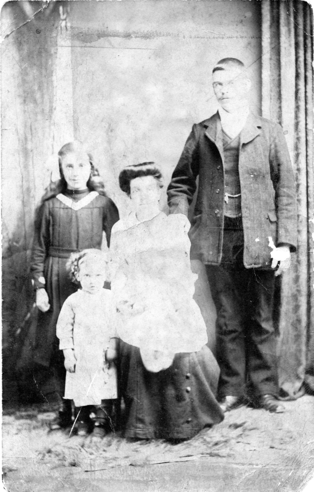 Robert and Lucy Lambert with my grandmother Florence on her knee, Edith is the small girl and Fanny Lambert is the older girl...jpeg
