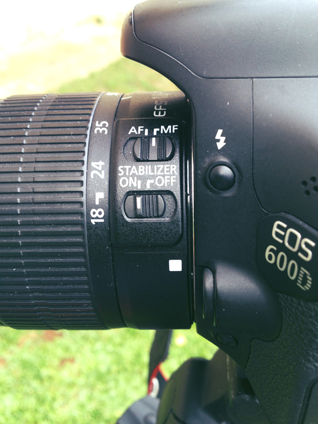 Switch it from AUTO FOCUS (AF) to MANUAL FOCUS (MF)
