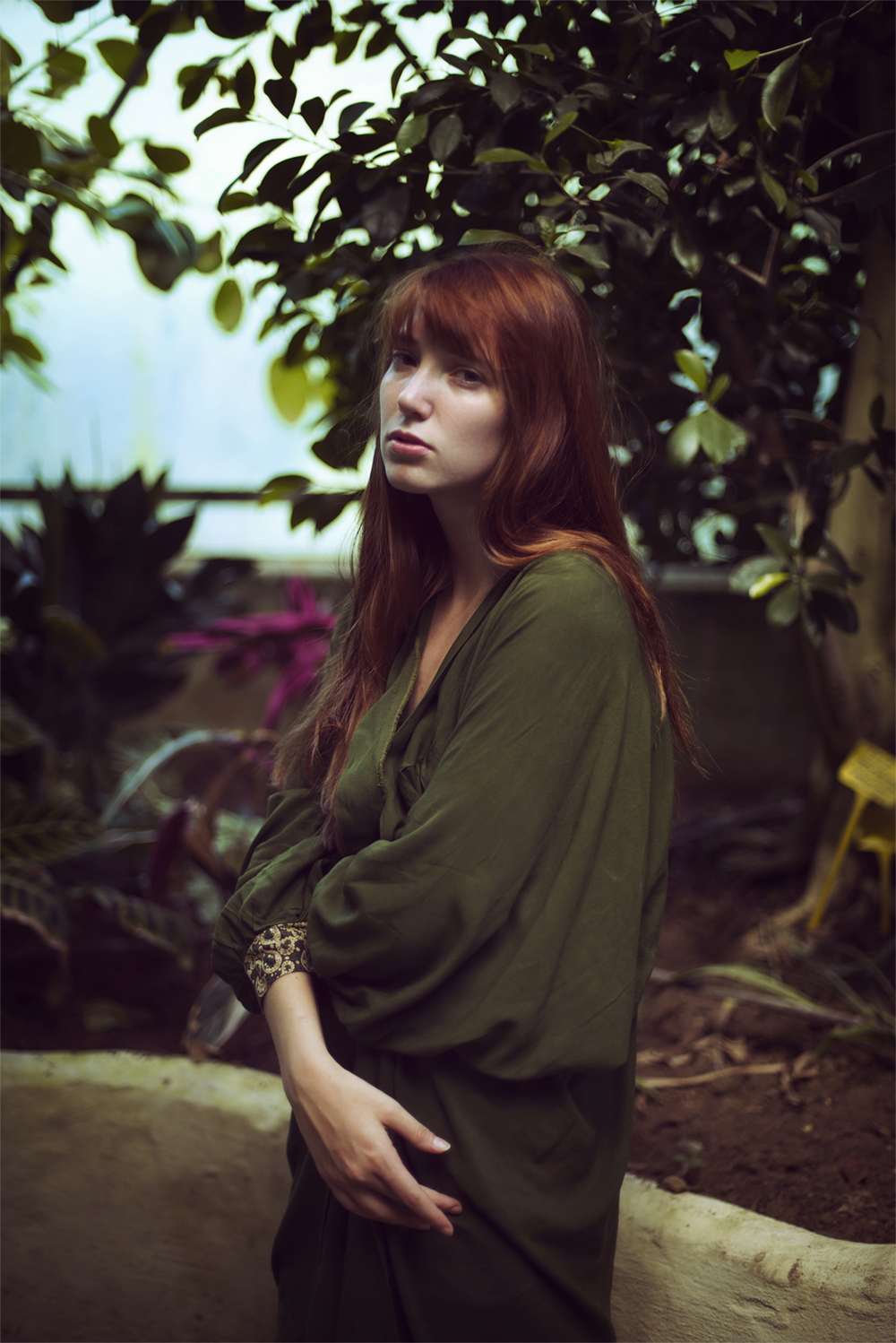 Redhead model portrait with plants