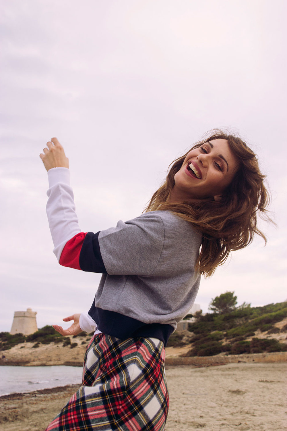 model laughing on sandy beach
