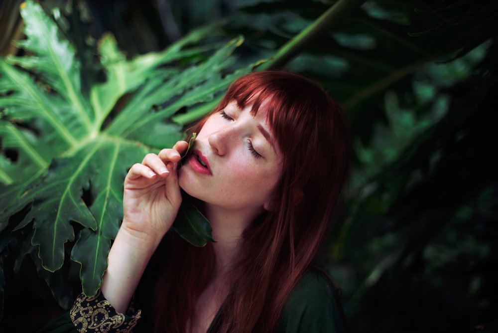 Portrait of a redhead model with plants