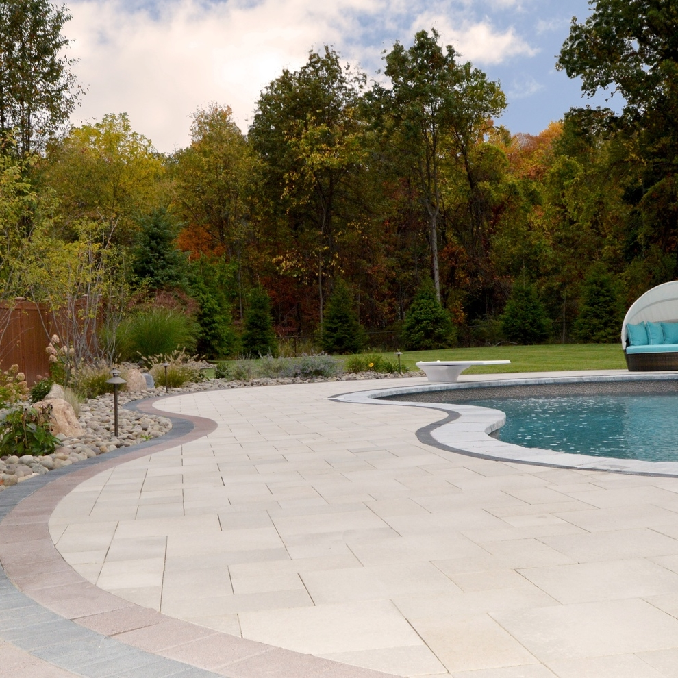 For this Hudson Valley poolscape, the Landworx design team artfully combined paver choices from Unilock's Select line. Complete with outdoor kitchen, landscape lighting, and trademark plantings, this pool has been officially Landworx'd.