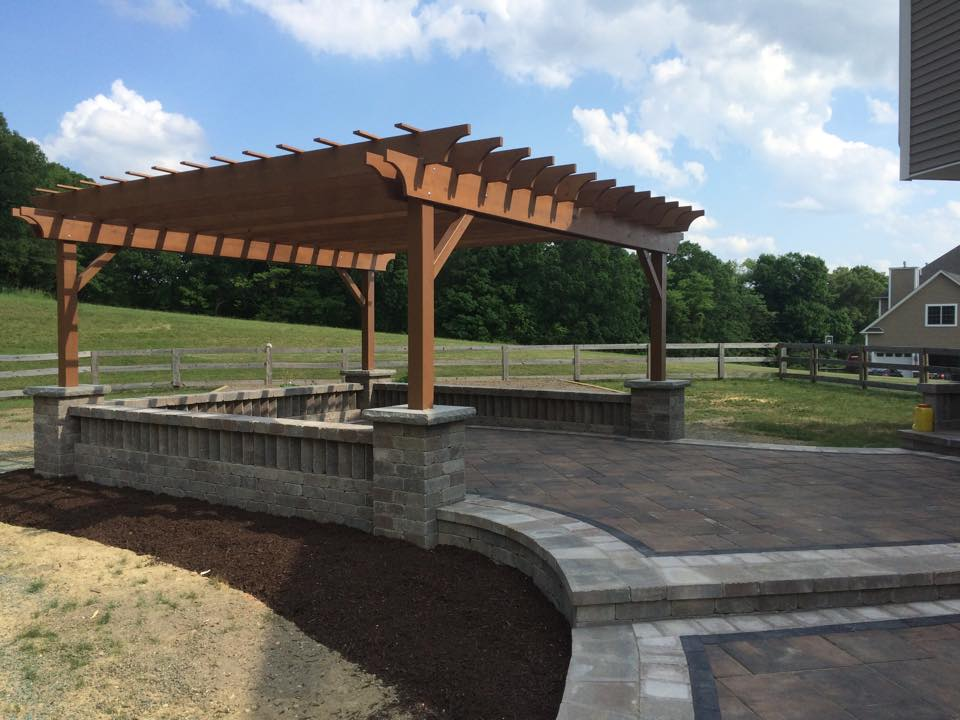 Unilock patio, seat walls, pillars, and custom pergola in Warwick, NY.