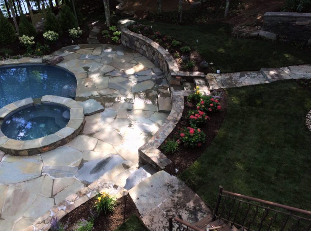 Top landscape design with patio, retaining wall and swimming pool in Chester NY