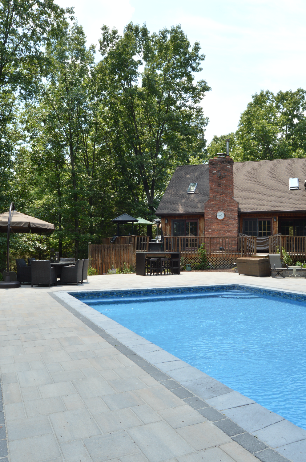 swimming patio made with Techo Bloc concrete pavers in Sugarloaf, NY