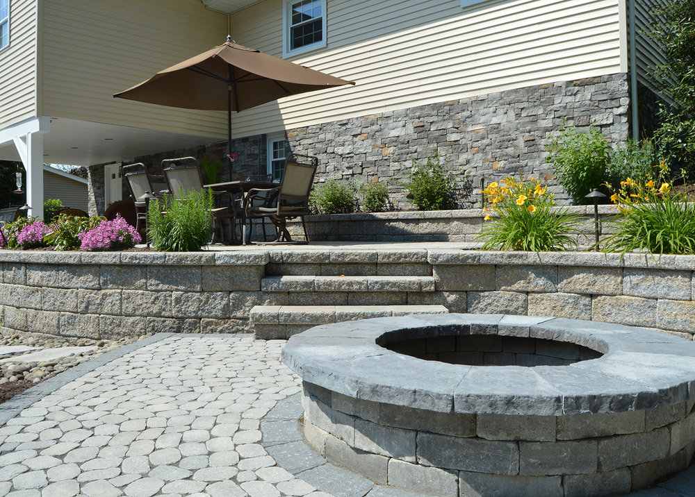 Balancing Landscape Elements with a Fire Pit in Pine Island, NY
