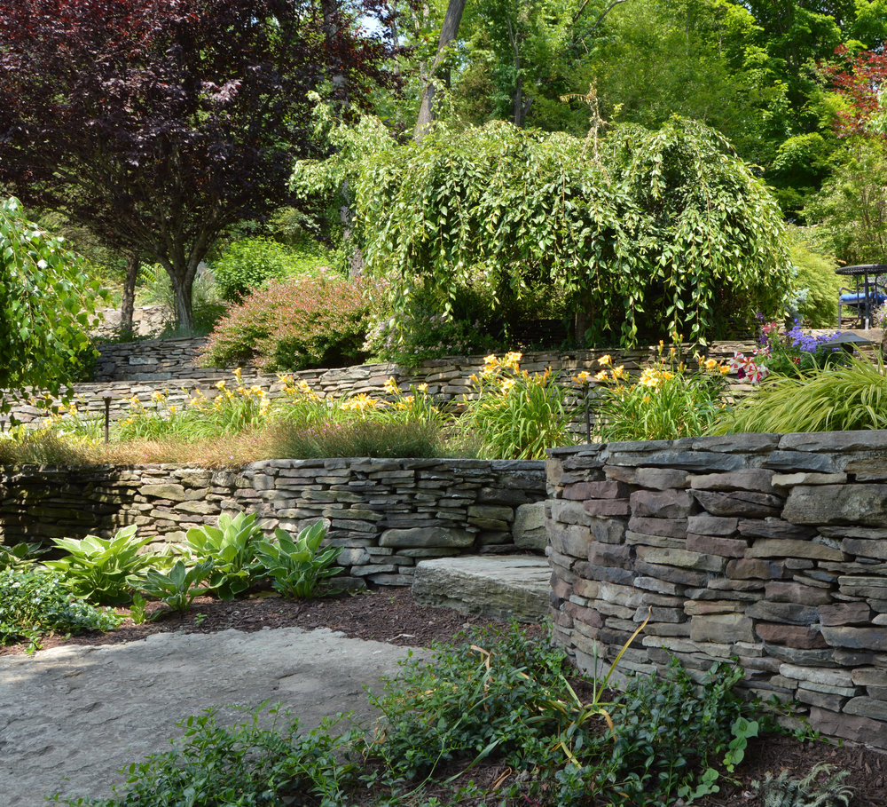 Four Innovative Ways to Use Retaining Walls in Your Warwick, NY, Landscaping