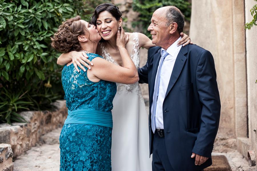23_Destination_Wedding_in_Monemvasia_bride_parents_kiss.jpg