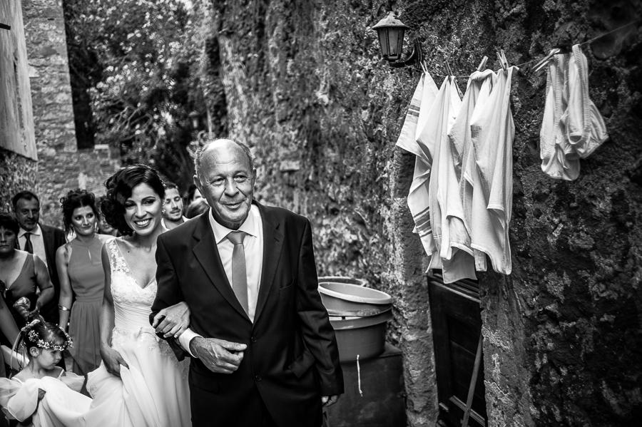 27_Destination_Wedding_in_Monemvasia_bride_father_great_smile.jpg