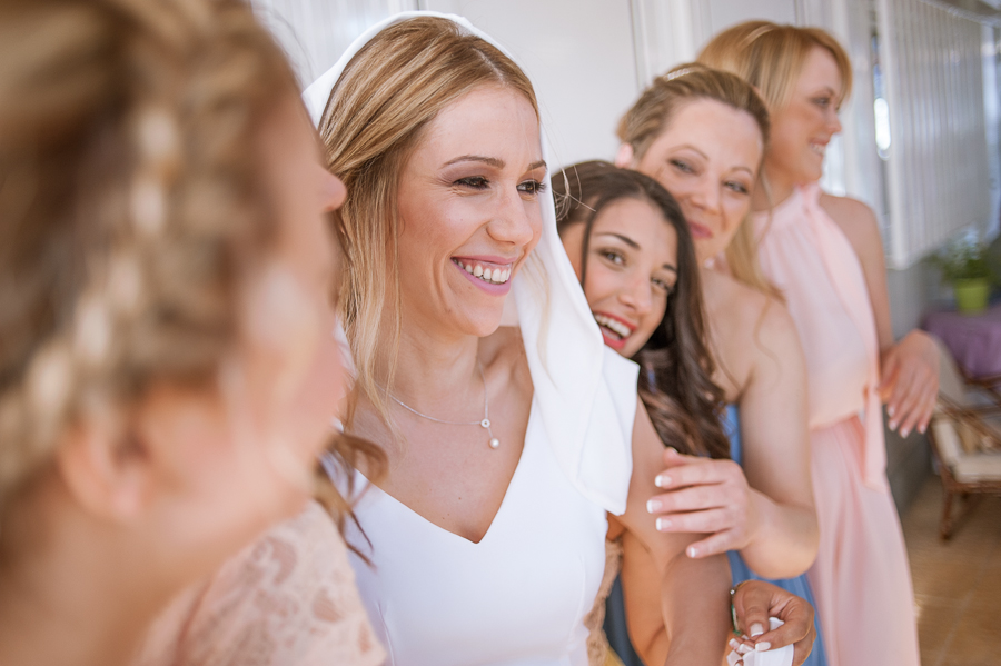16_Wedding_In_Athens_Koropi_bride_friends_smile.jpg