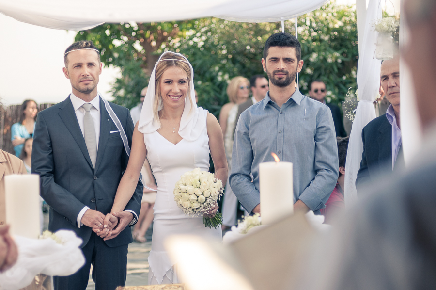 37_Wedding_In_Athens_Koropi_holding_hands.jpg