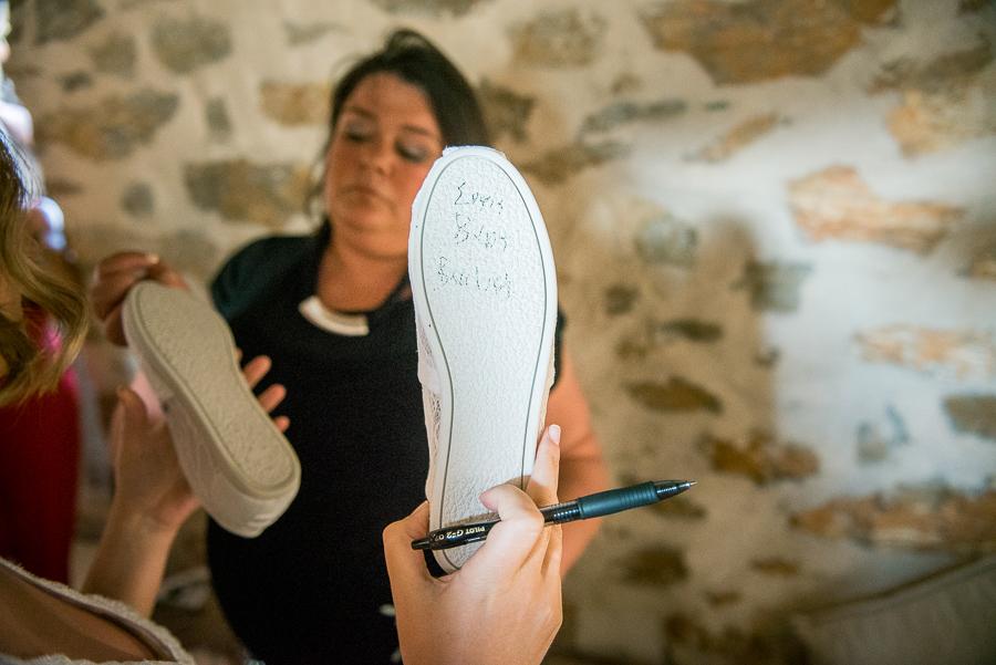 63_Wedding in Folegandros shoe naming.jpg
