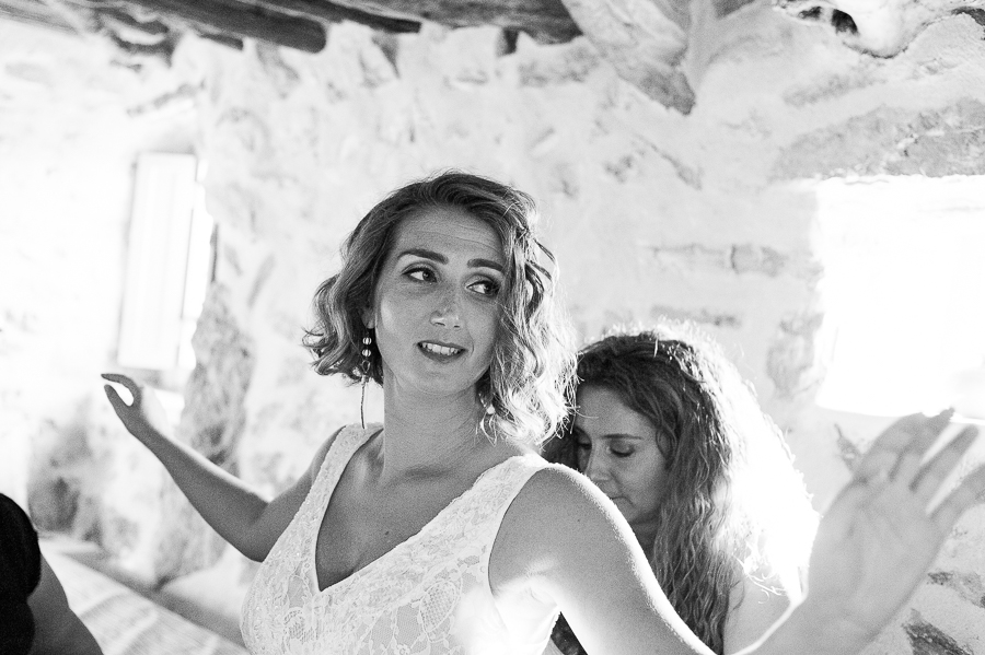 65_Wedding in Folegandros bride put dress.jpg