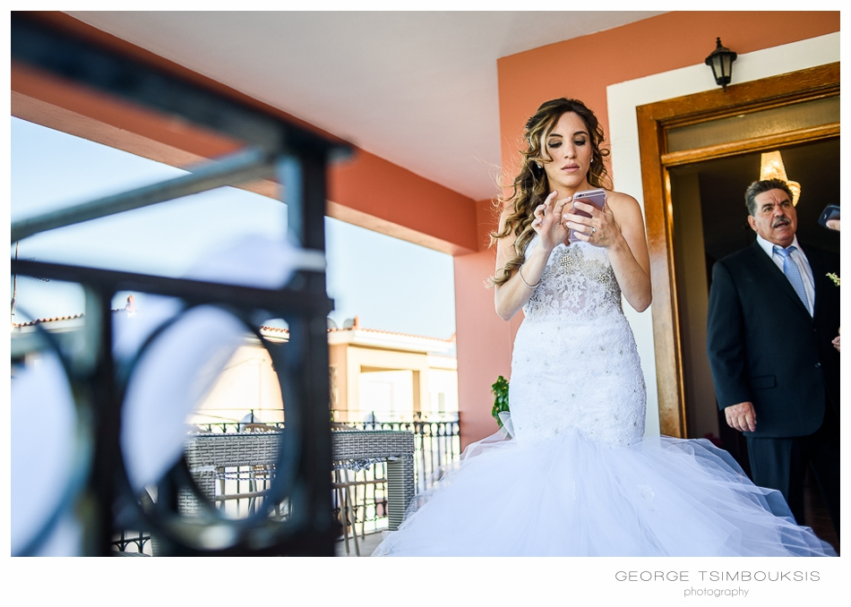 85_Wedding in Chios brides phone.jpg