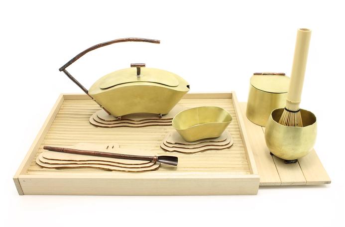 Oi Ying Valerie Ho -  Clanking     16 cm x   30 cm x 18 cm    Copper, brass, wood