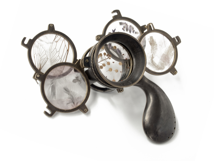 "Johanna Typaldos -  Lenses     5""   x 3"" x 3""    Brass, silver, lepidolite, organic materials"