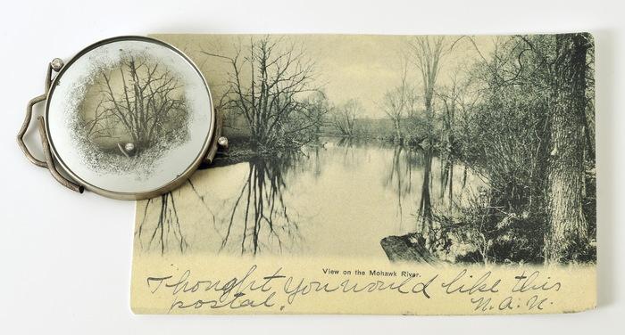 "Jude Clarke      Retrospective: Mohawk River , 2018     sterling, distressed mirror, vintage postcard, diamonds 3.5"" x 6.25"" x .25"" $1200.00"