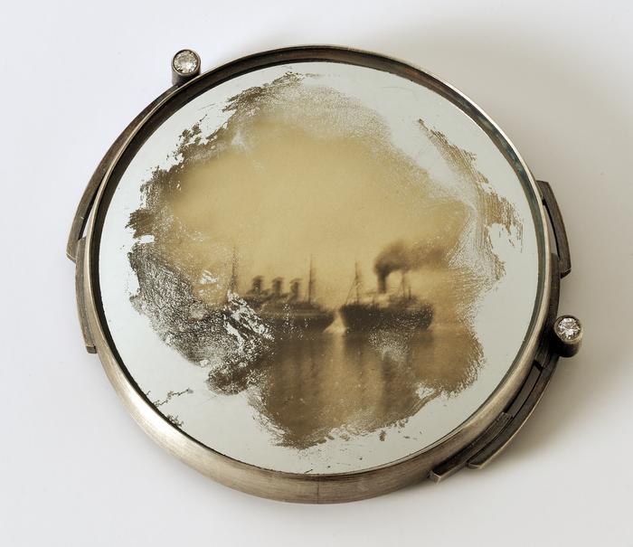 "Jude Clarke      Retrospective: Passage , 2018 sterling, distressed mirror, vintage photo, diamonds 2"" x 2.25"" x .25"" $1200.00"