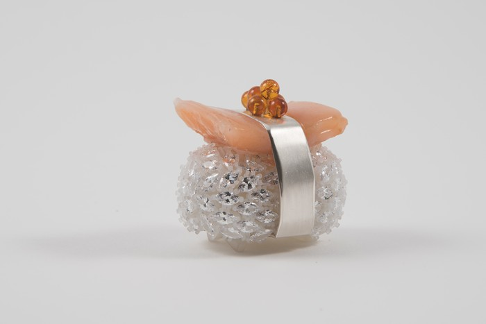 """Julie Goldberg      Salmon Sushi Brooch , 2018 3D printed resin, silver, silicone, cubic zironia, amber 2"""" x 2"""" x 1.6"""" $500.00"""