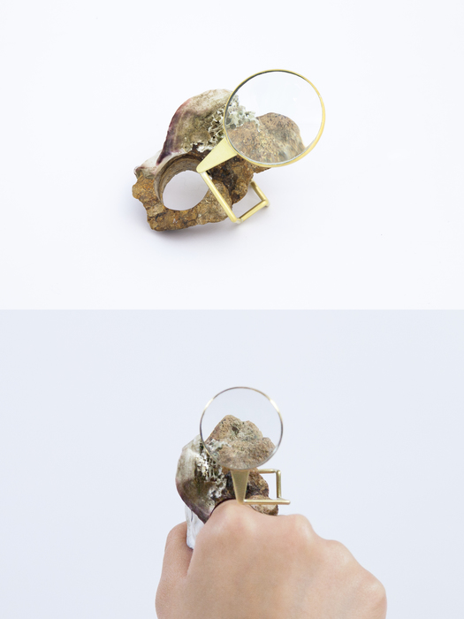 Oi Ying Valerie Ho    Lens-scape of Hong Kong , 2018 Sandstone, Brass and Convex Lens 6 cm x 3.5 cm x 4.5 cm $135.00