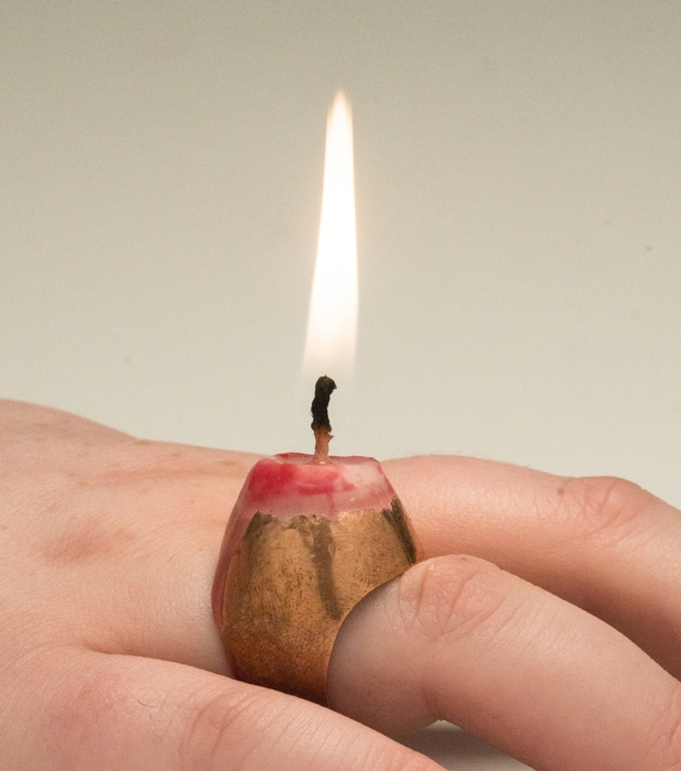 """Linore Huss      Love Will Light the Way,  2017 Copper formed and soldered ring, set wax candle 1.5"""" x 1"""" x .8"""" $120.00"""