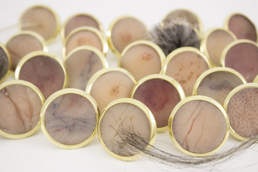 "Year 30: Age Badges,  2016   brass, nickel, silicone, pigment, synthetic hair, fibers 1"" x 1"" x 1"" $2400.00"
