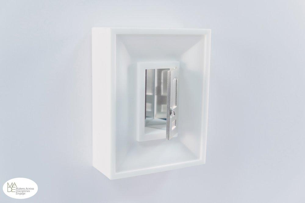 "Chang Bao -  Enter   5"" x 4"" x 2"" SLS Nylon, acrylic mirror, sterling silver"