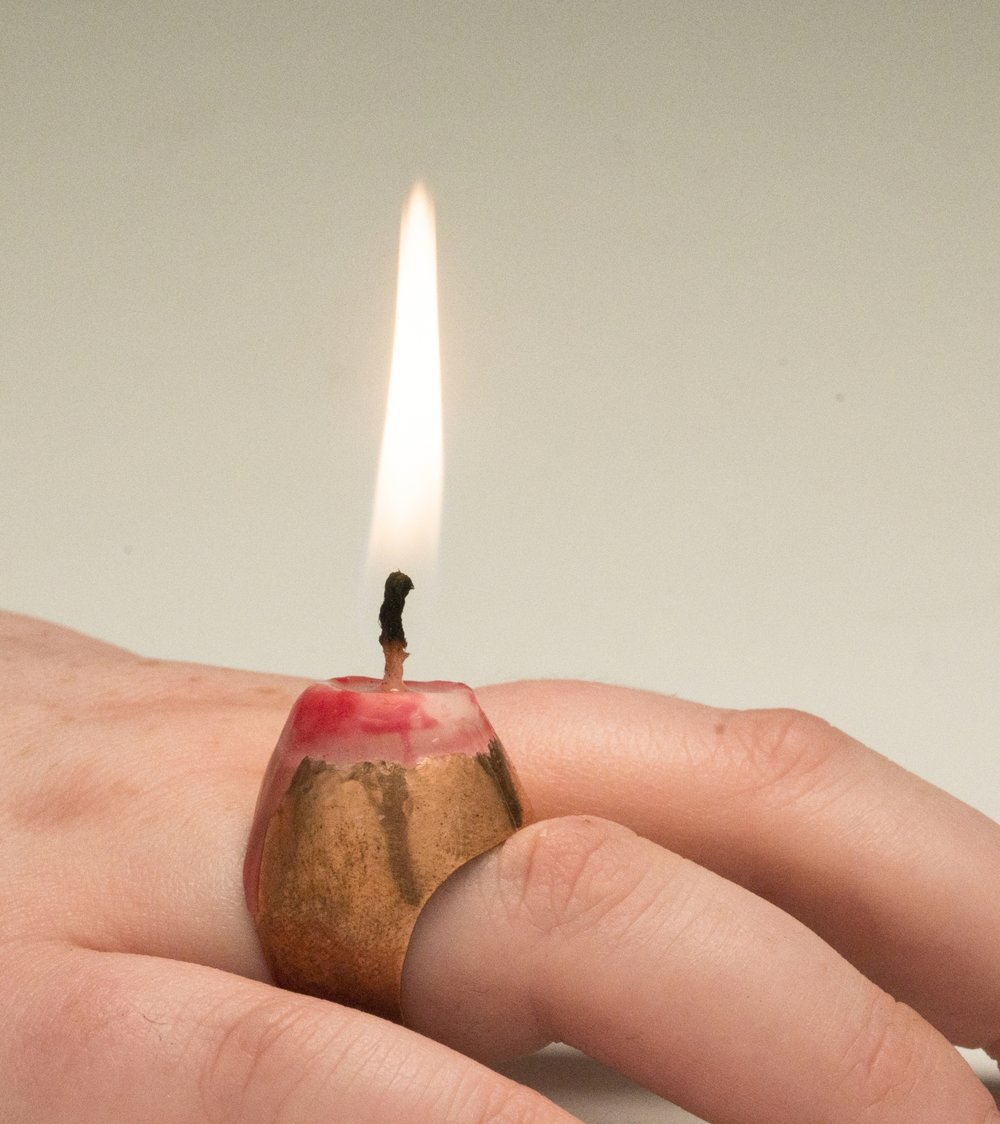 "Love Will Light the Way,  2017 copper formed and soldered ring, set wax candle 1.5"" x 1"" x .8"" $120.00"