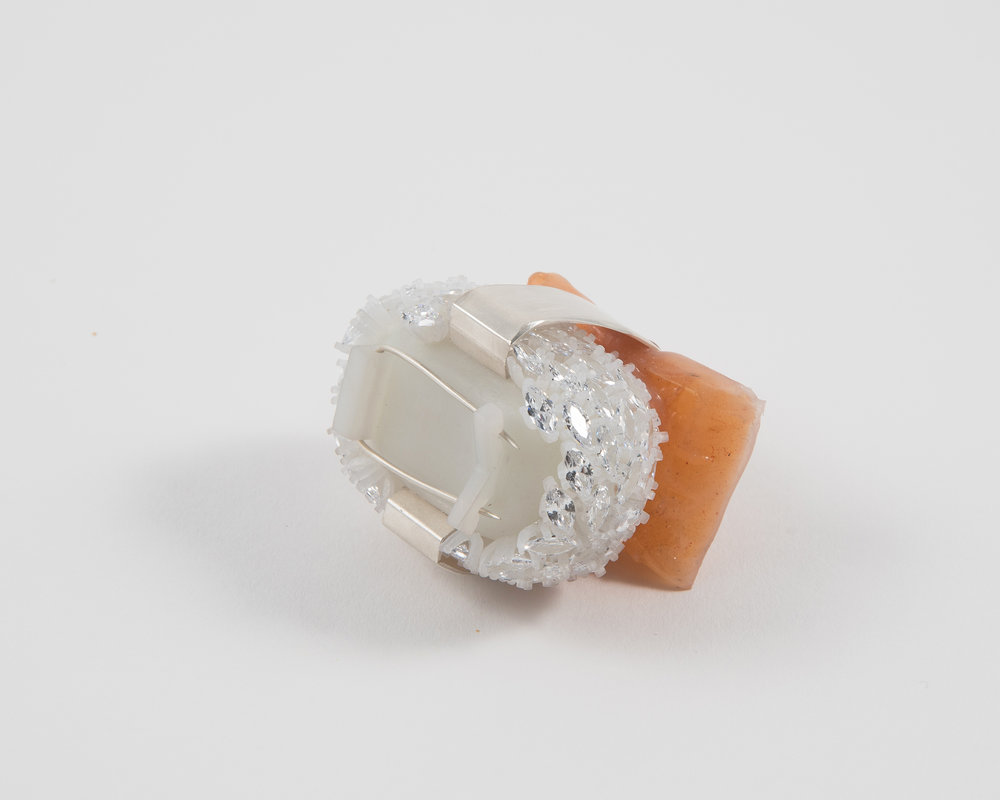 "Salmon Sushi Brooch , 2018 (back view) 3D printed resin, silver, silicone, cubic zironia, amber 2"" x 2"" x 1.6"" $850.00 Photo credit: Elyse Sawka"