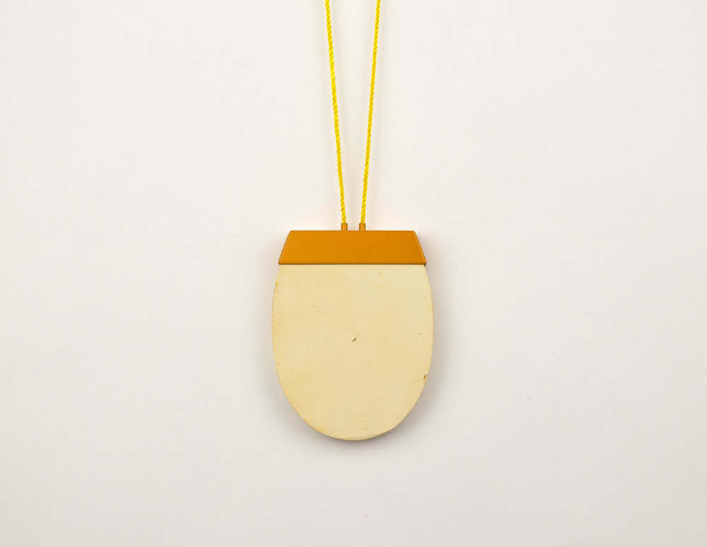 "Yellow Chalk,  2018 chalk, brass, powder coat, nylon 18"" x 2.25"" x .5"" $400.00 Photo credit: artist"