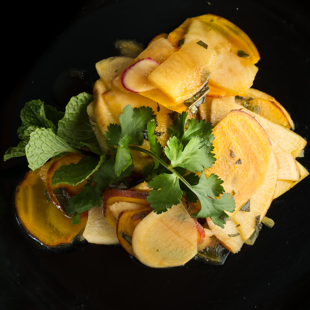 Blood orange vinaigrette with shaved raw root vegetable salad
