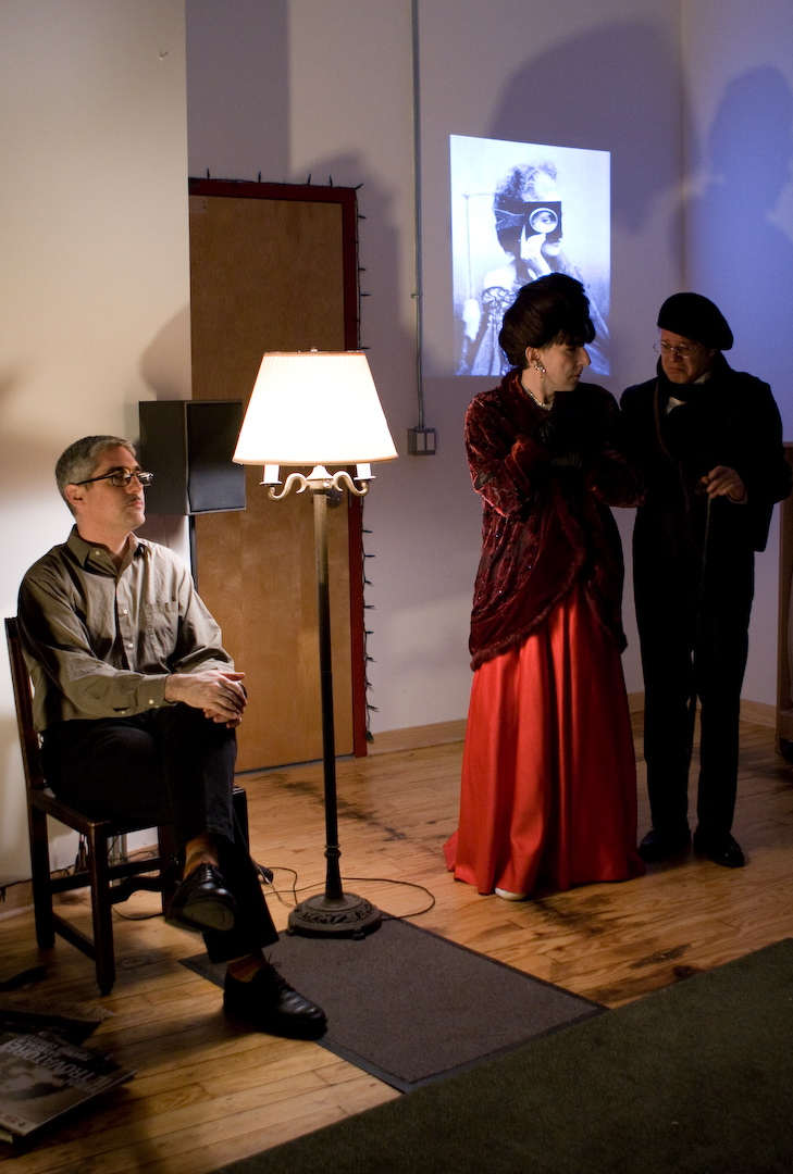 The Narrator (Doug Stapleton), Natasha R (Jeff Abell) and Marcel Piron (Douglas Grew)