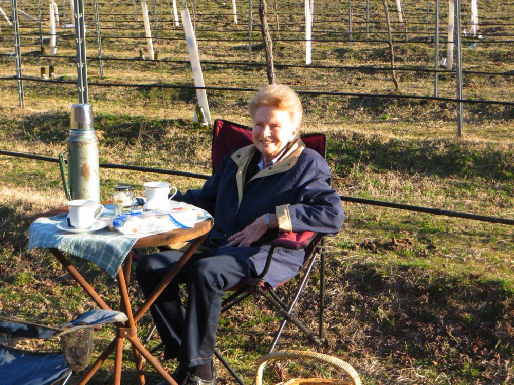 Nana, having a break from pruning and enjoying a hot cuppa