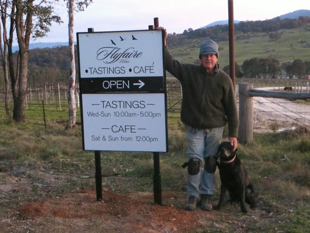 Les, our Winemaker, and our trusty vineyard dog, Fox, at the entrance to Flyfaire Wines