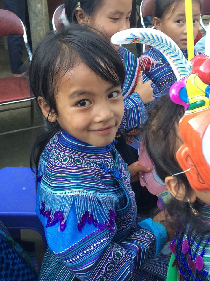 Local Vietnamese children celebrating the moon festival. The charity brought along a small truck load of goodies for these beautiful kids and lots of fun was had by one and all!