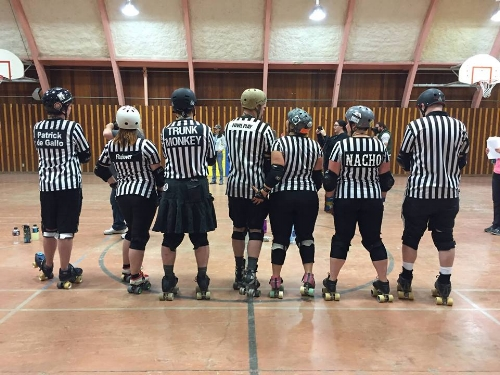 Fowl Play and Doom Dee Doom (center) behave TOTALLY PROFESSIONALLY at a Los Alamos Derby Dames scrimmage. Photo by Scott Engeman 2016