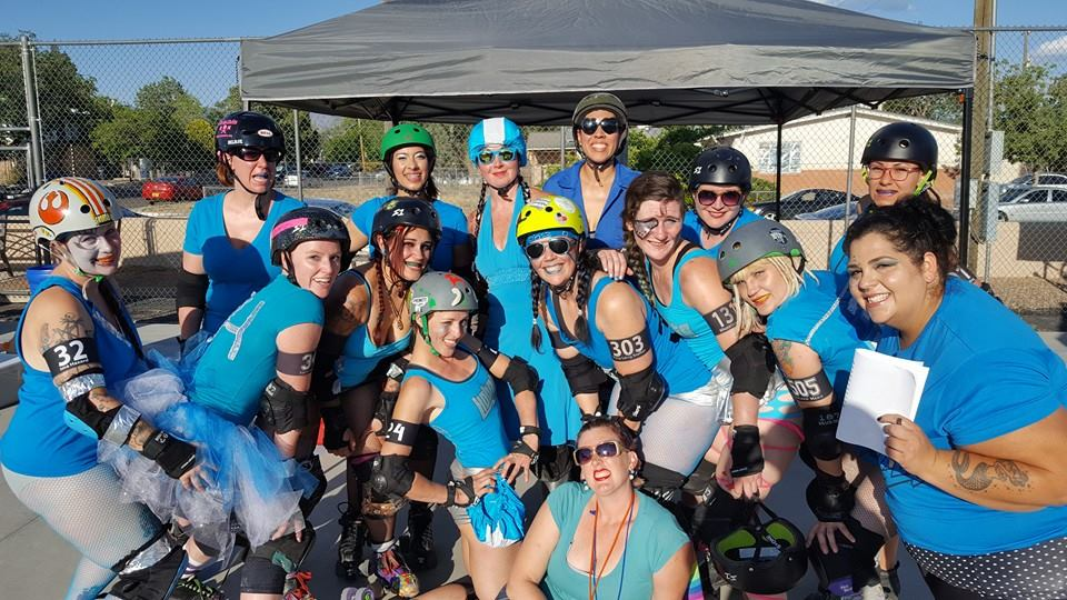 Ima Hazard (far left, floofing tutus) poses with the Hobots at the May DCRD home team bout.