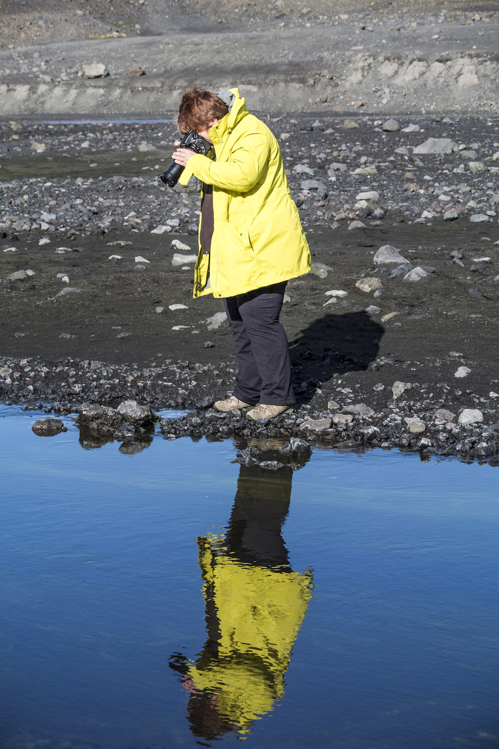 Kathy in Iceland, photographing algae in a volcanic pool.