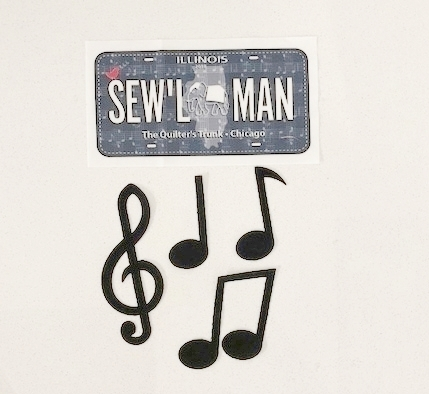 We have Kits for the Row in the shop. We also have Finishing Kits if you want to add the borders and binding like we did for our shop sample. - Don't forget to pick up your SEW'L MAN license plate! And, we have pre-fused Music Note appliqués available in the shop to embellish your project!