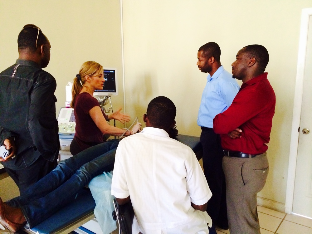 Lori Strachowski, MD, volunteer from UCSF Medical Center,teaching HaitianOB/GYN physicians how to perform breast ultrasound