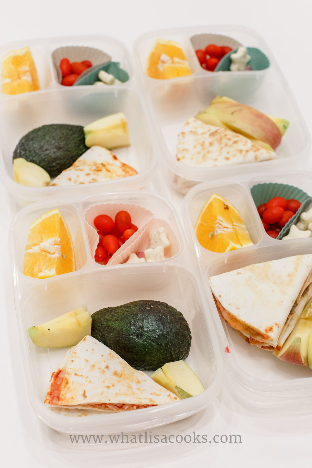 Pizzadillas: tortilla with mozzarella cheese and tomato sauce.  With apples, avocado, tomatos, orange slices, and yogurt covered star cookies.
