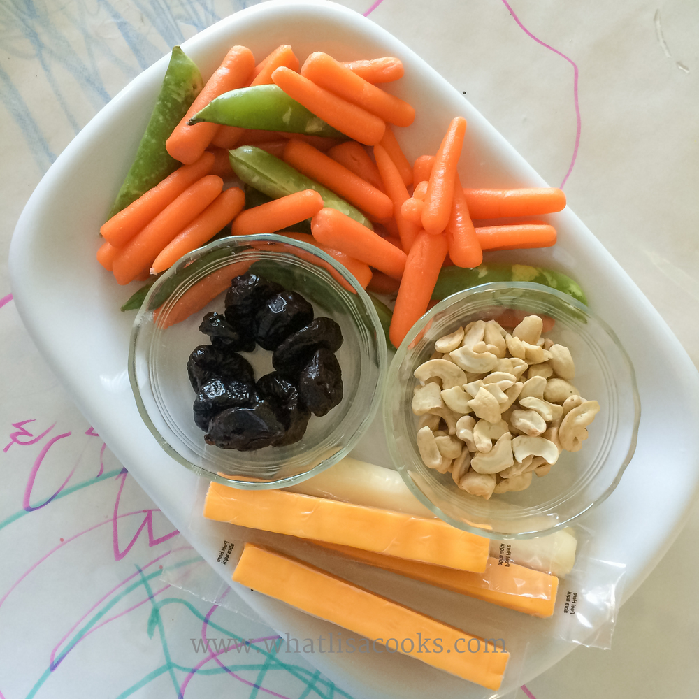 Carrots, sugar snap peas, prunes, cashews, cheese.