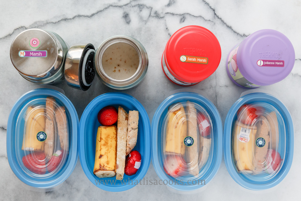 Homemade instant oatmeal ,  homemade biscotti , banana, strawberry, and cheese. The blue containers are from Ikea. The oatmeal is packed in  Thermos Funtainers . I heat the container with boiling water first, and then put in the dry oatmeal mixture with boiling water and boiling milk, so it all stays warm until lunch time.