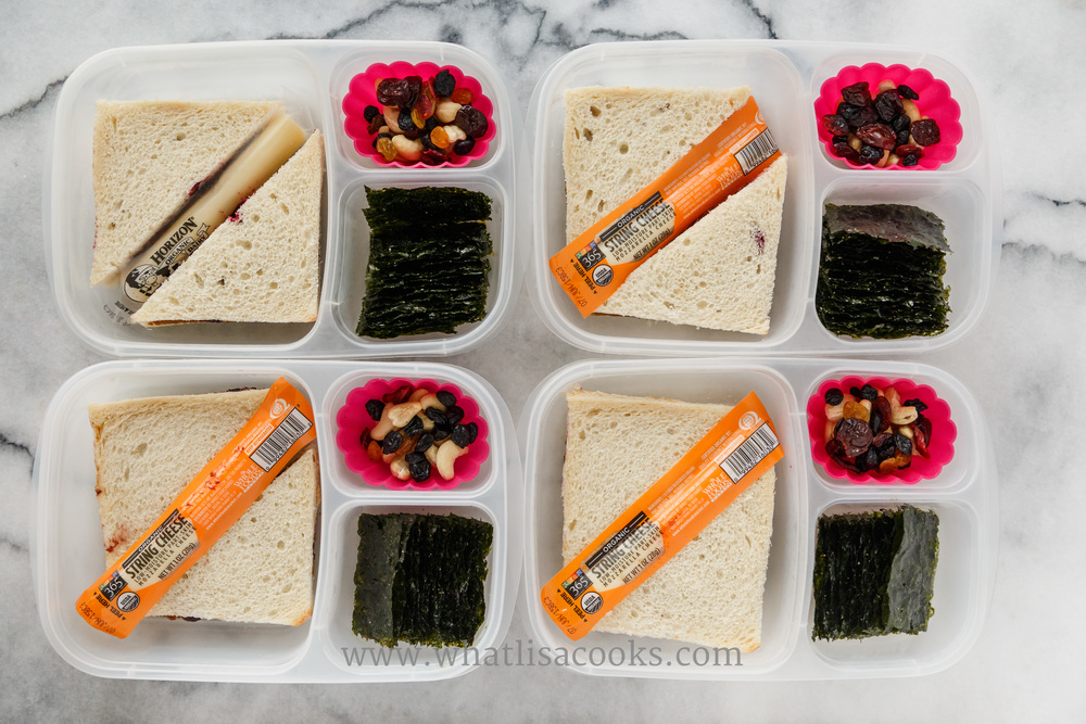 Easy Friday Sandwich lunch: sunbutter and homemade jam on local white bakery bread, organic string cheese, seaweed snacks, dried fruit & cashews. Packed in  Easy Lunchboxes . The pink silicone cups are from Ikea.