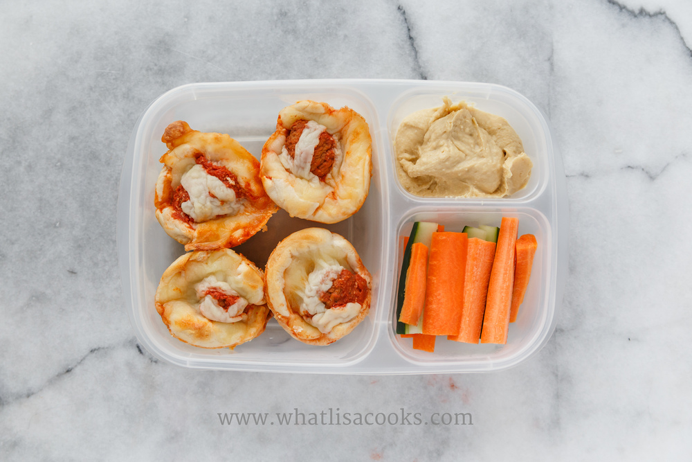 """Grown ups like 'kid food' too. A work lunch for my husband: meatball muffins, carrots, cucumbers, hummus for dipping. His lunches are packed in an  """"Urban"""" Easy Lunchbox  (same as the kids boxes, but with more grown up colors)."""