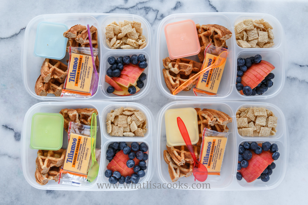 Homemade waffles, with maple whipped cream for dipping (just whipping cream, with maple syrup), cheese, rice chex, apples, and blueberries.  Packed in  Easy Lunchboxes , with  Mini Dippers , and  Little Spoons .